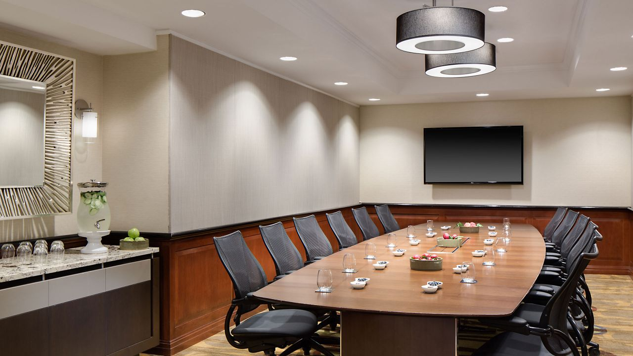 Large table with office chairs in executive boardroom