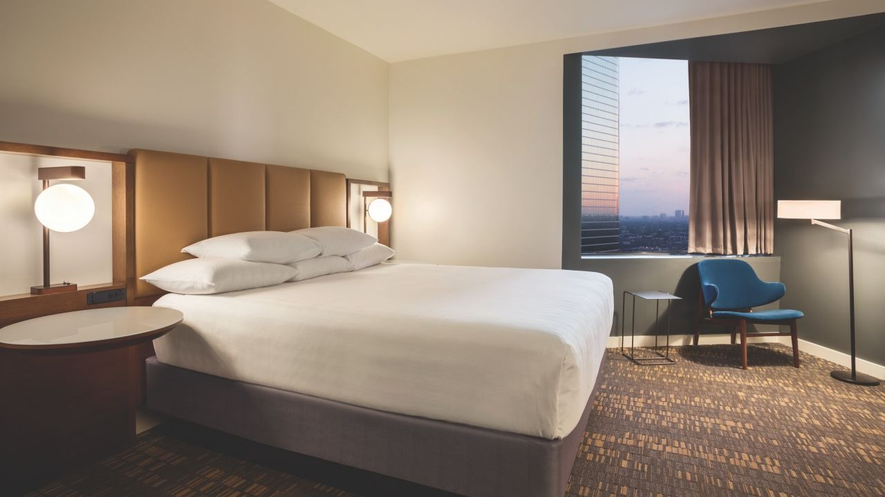 Hyatt Regency Houston imperial suite guest room with king sized bed