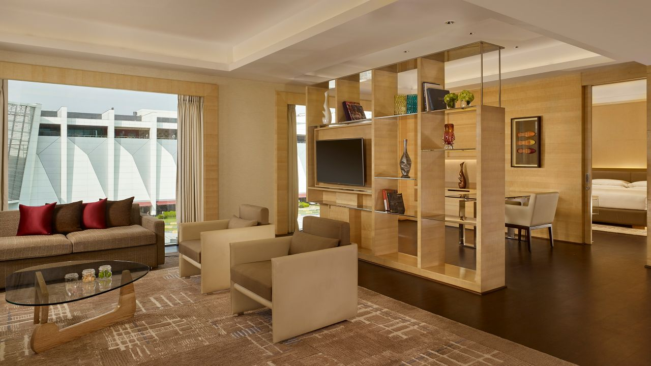 Dining, living and bedroom areas of hotel suite