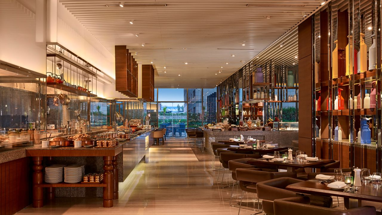 Long view of tables and chairs in restaurant at Hyatt Regency Chandigarh