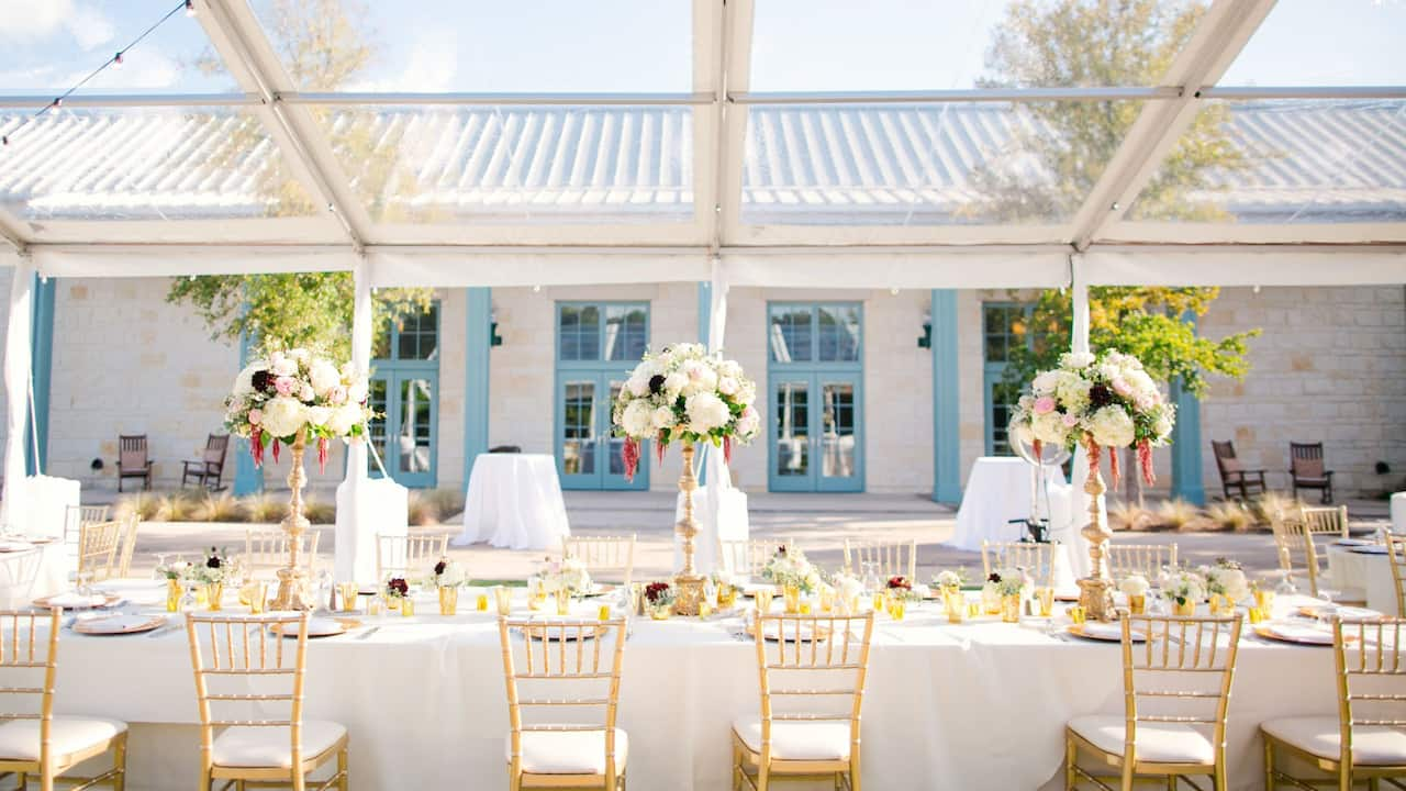 Wedding reception at Independence Lawn Tent Building at Hyatt Regency Hill Country Resort & Spa