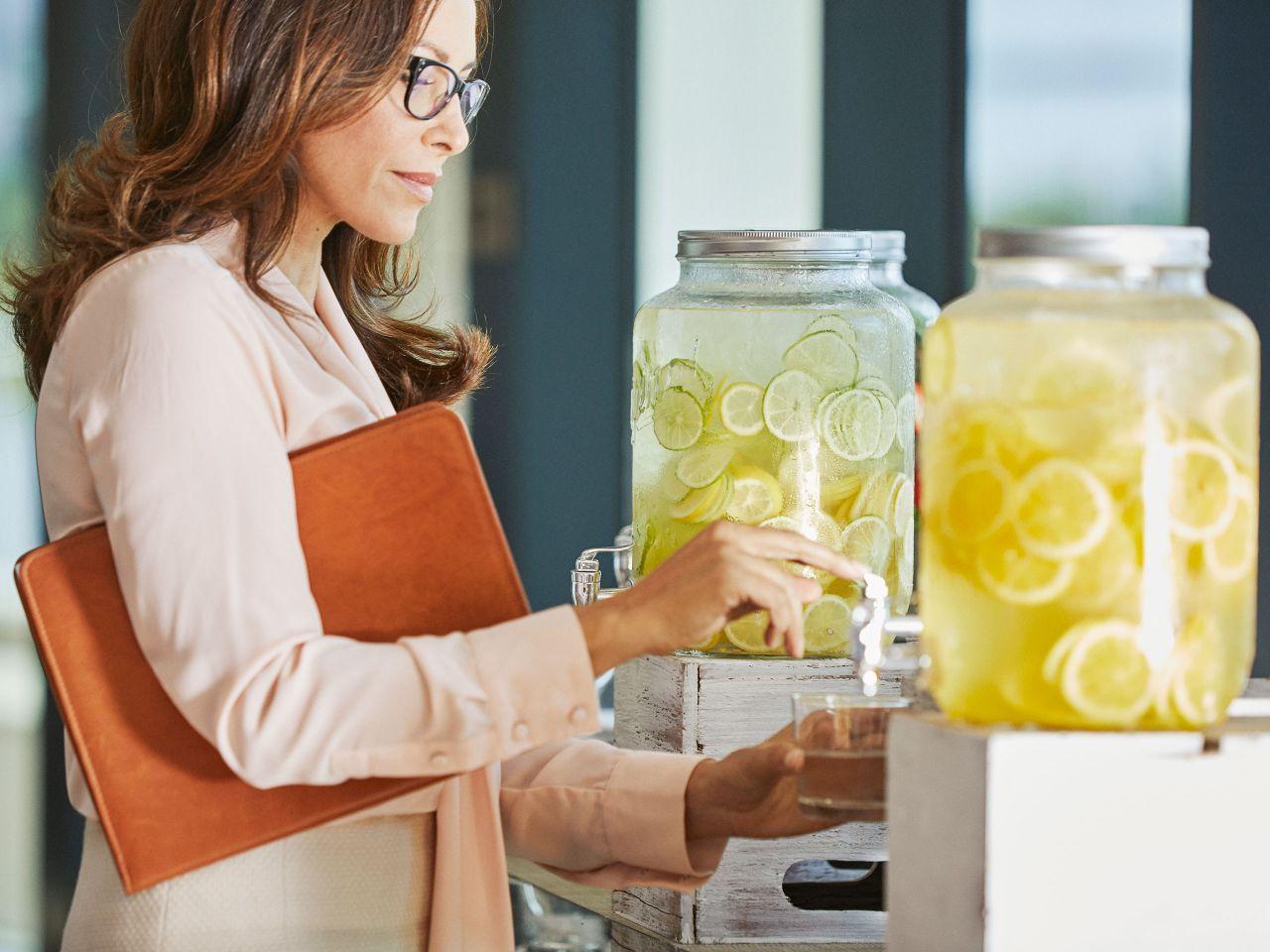Business woman having lemon water
