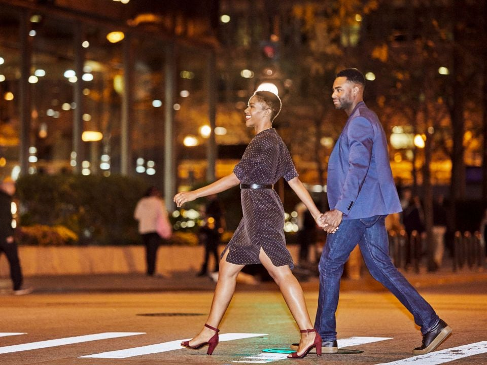 Couple crossing the street in a bustling city