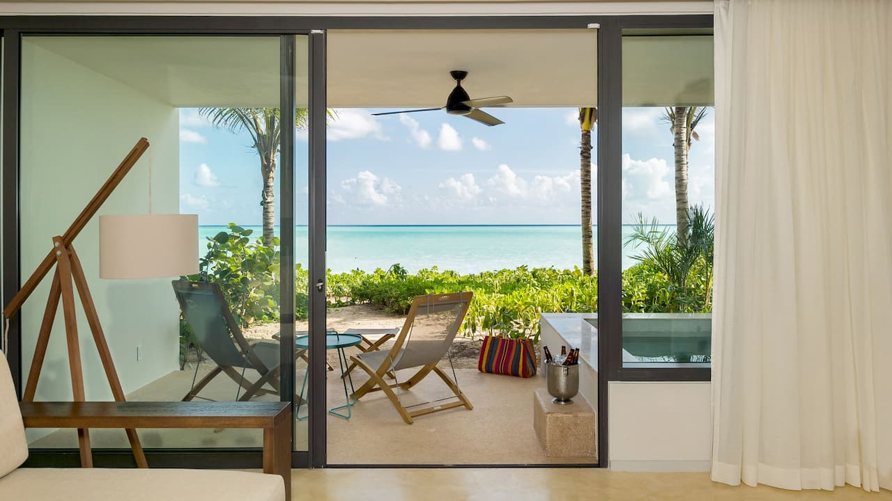 Andaz Mayakoba Resort Riviera Maya beach area suite bed