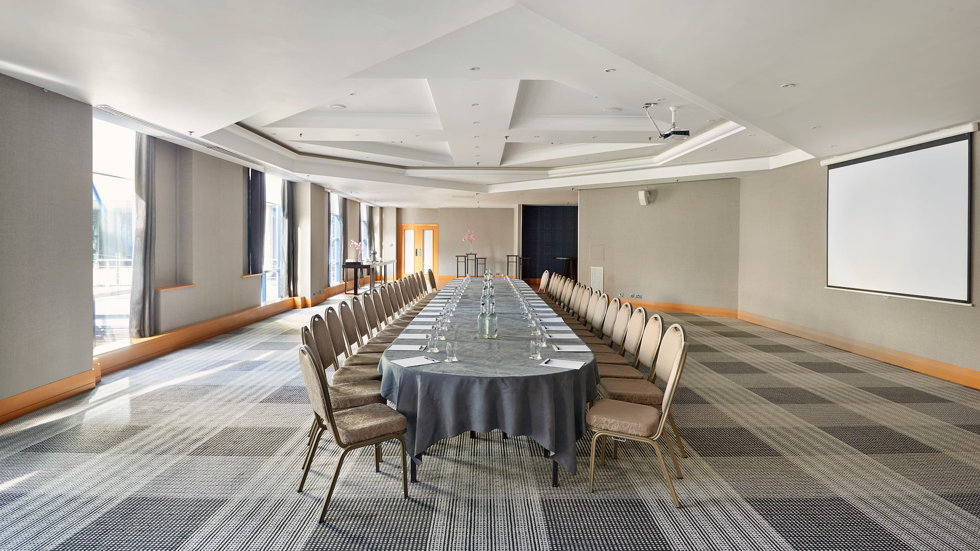 Boardroom setup with natural daylight and projector at Hyatt Regency Birmingham
