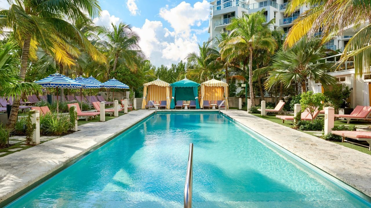 Hotel Swimming Pool with Cabanas in Miami Beach at The Confidante Miami Beach