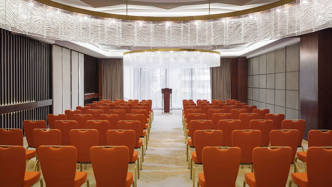 Rows of chairs in hotel ballroom