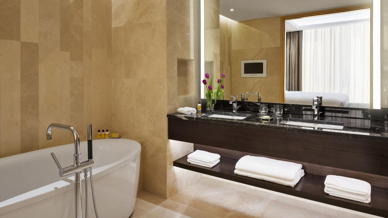 Beige marble bathroom in hotel suite