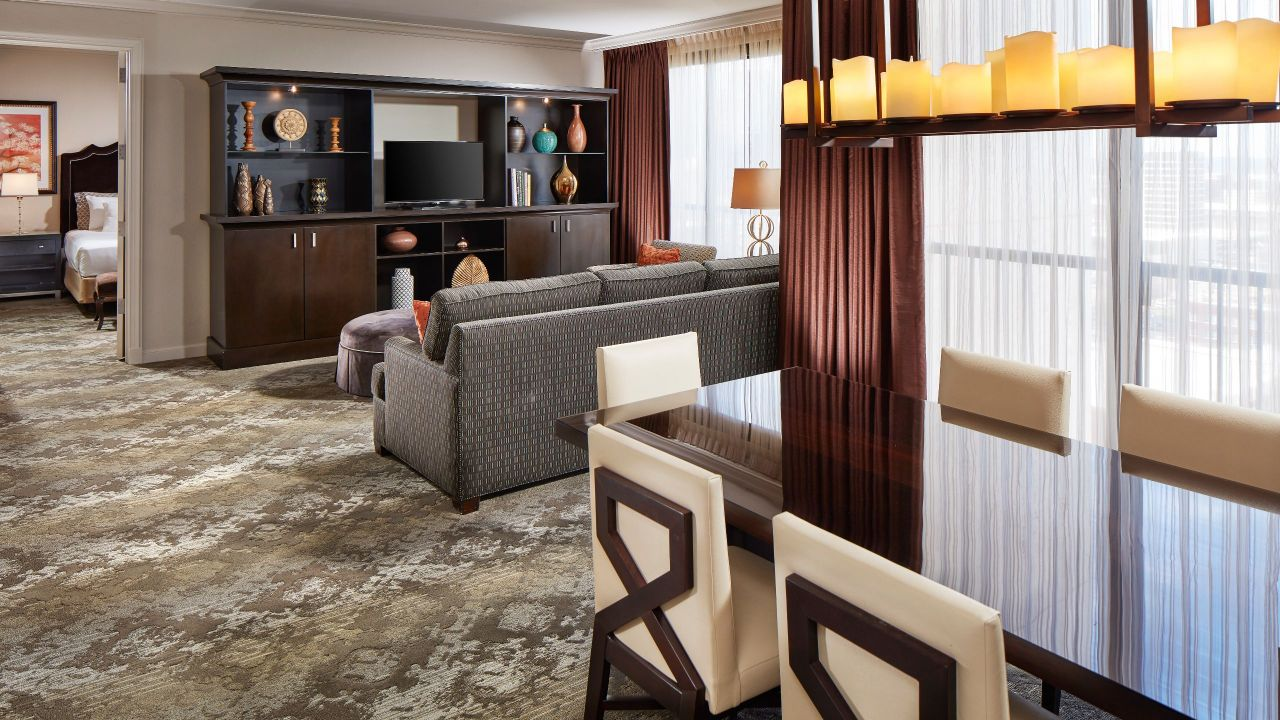 Sitting and dining areas in hotel suite