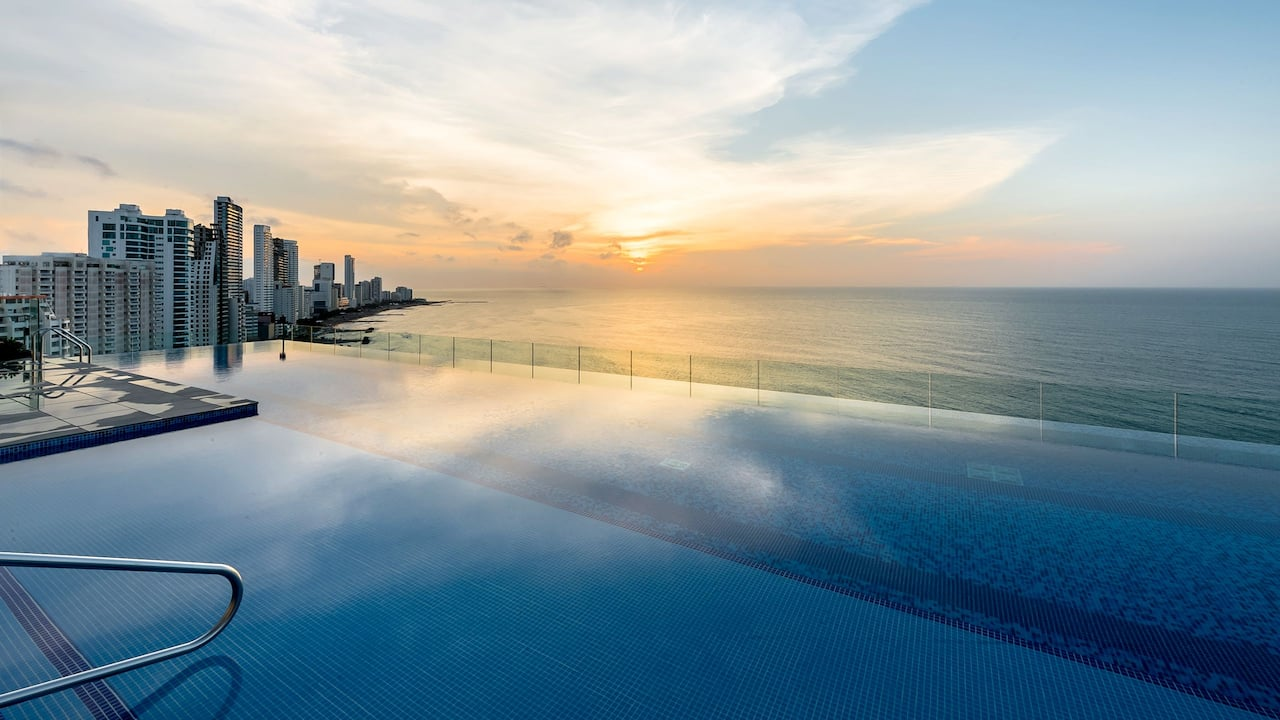 sunset lap pool with ocean view in the cartagena five star hotel