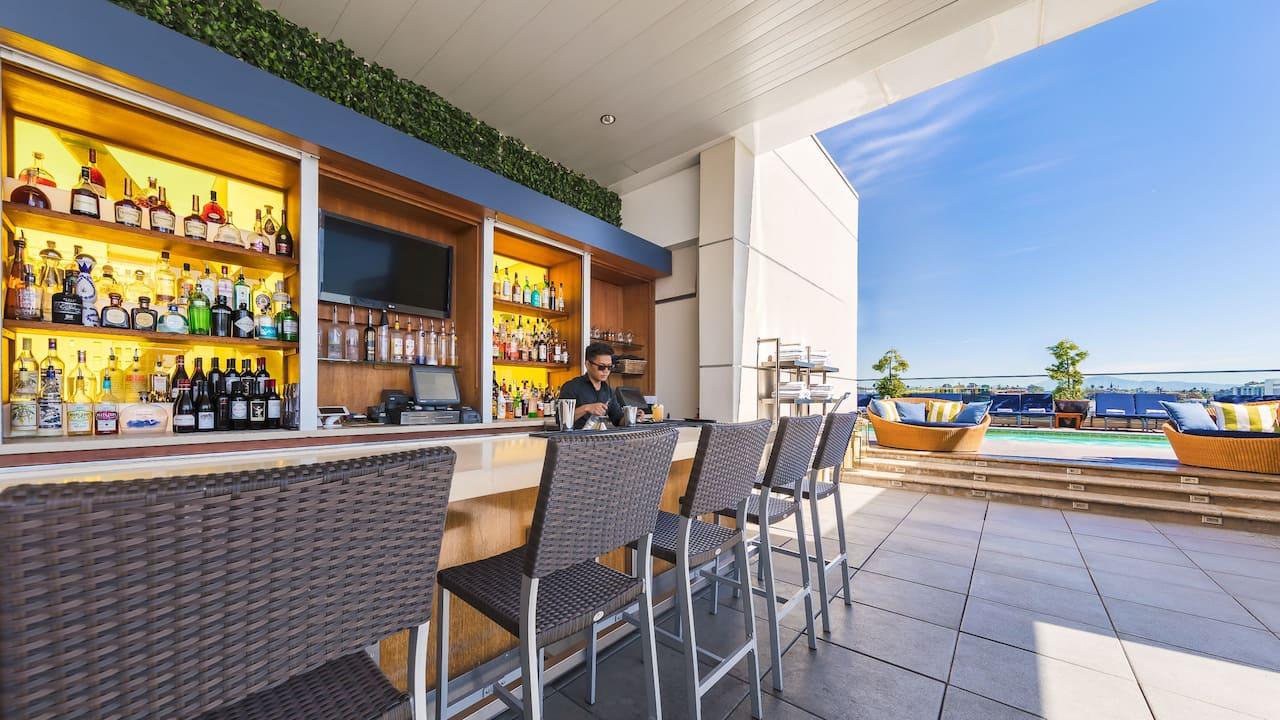 The Rooftop by STK restaurant on the roof with bar near pool