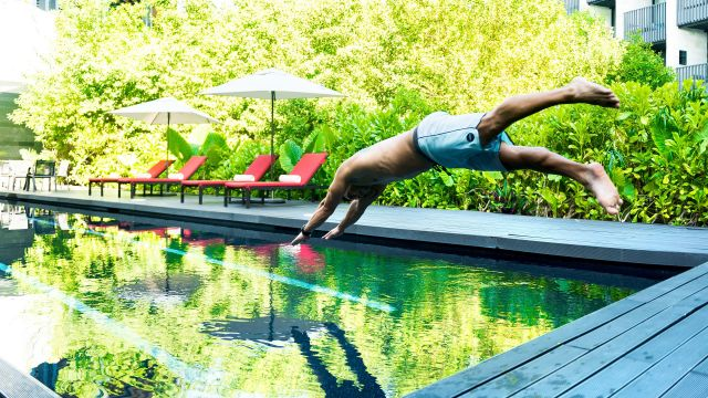 Man diving into pool
