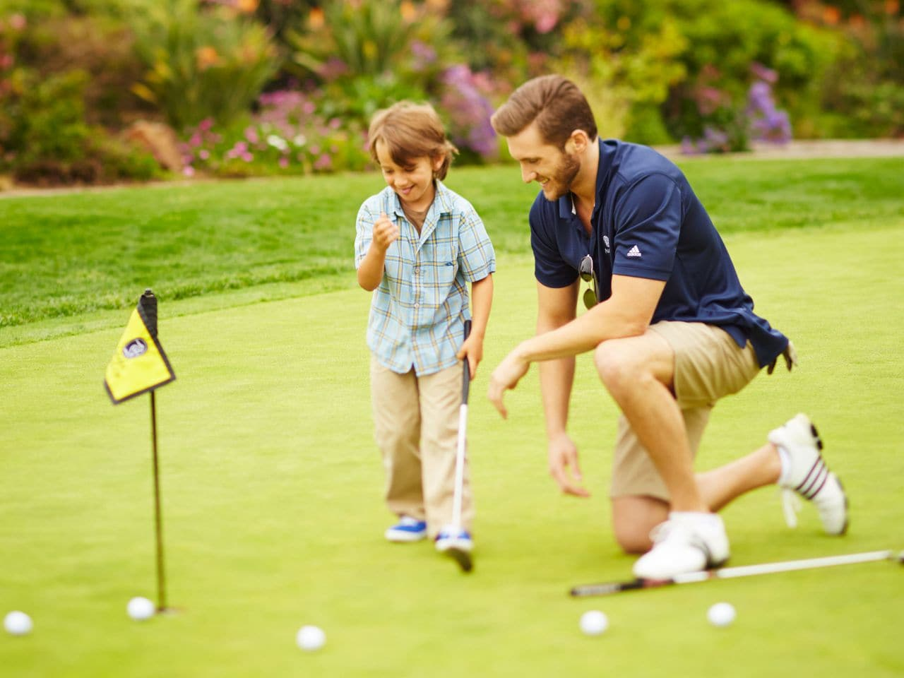 Dad and son playing golf