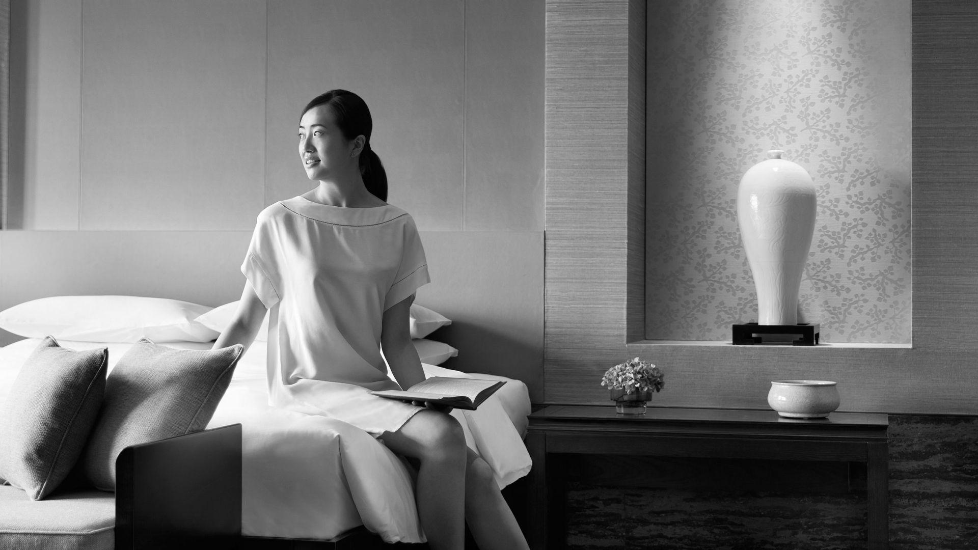 Woman in guestroom