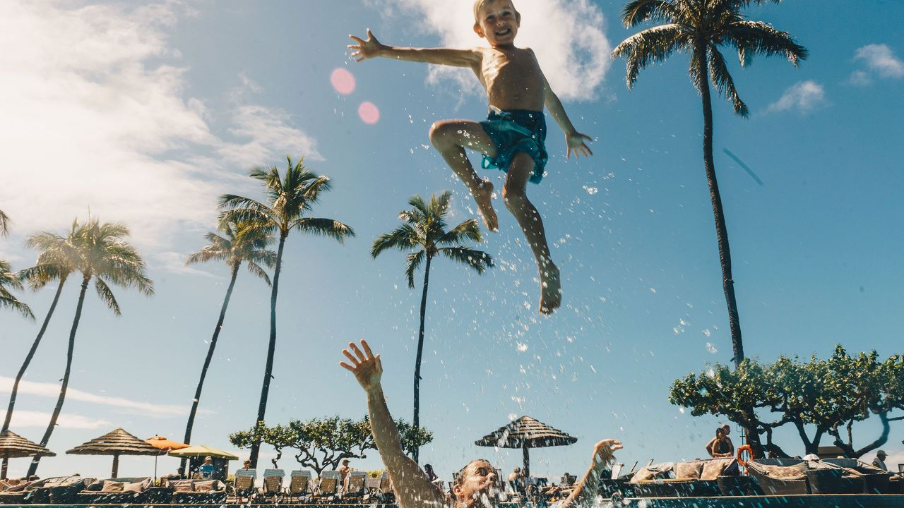 Family Enjoying Main Pool at Hyatt regency Maui Resort & Spa