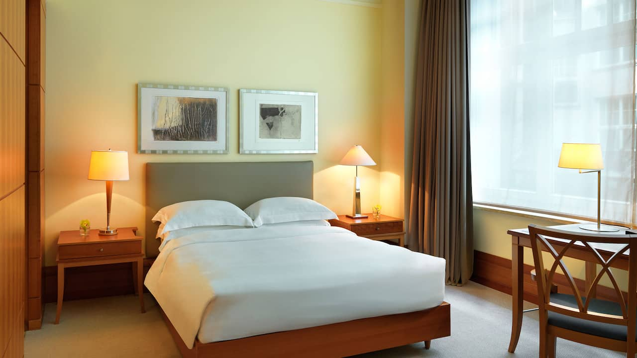 2 queen beds hotel room with club lounge access at park hyatt hamburg
