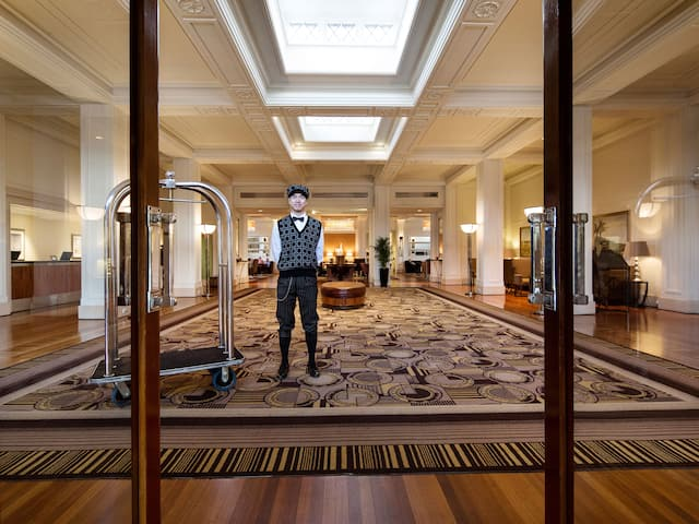 Hotel colleague standing in lobby