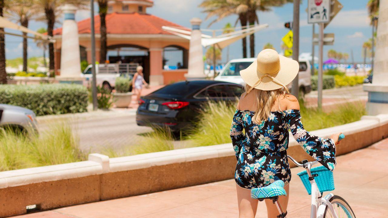 Woman with bike on beachwalk