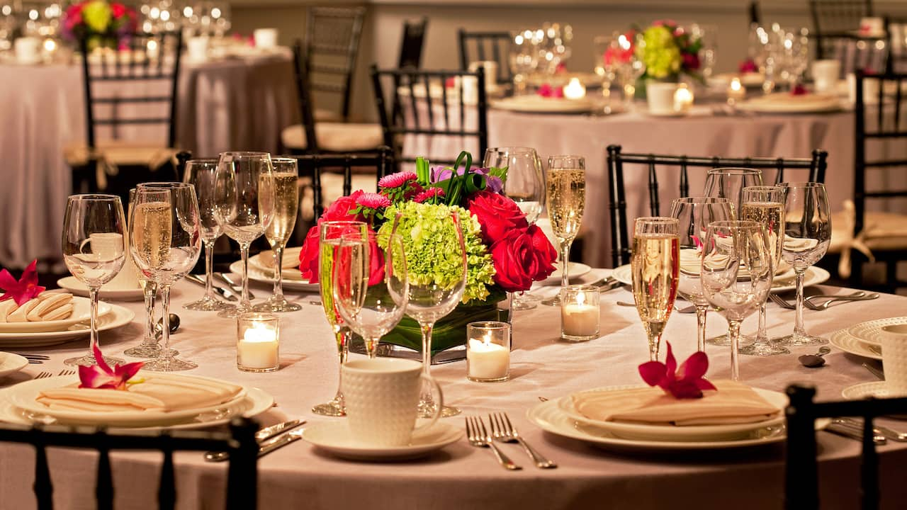 Elegantly designed table arrangements in Cape Cod Banquet room