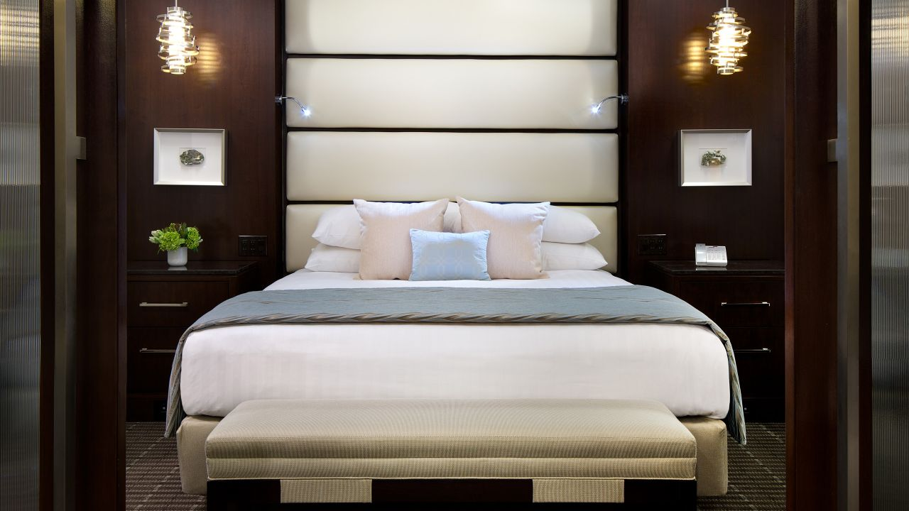 Comfy king-sized bed set in a beautifully designed suite bedroom