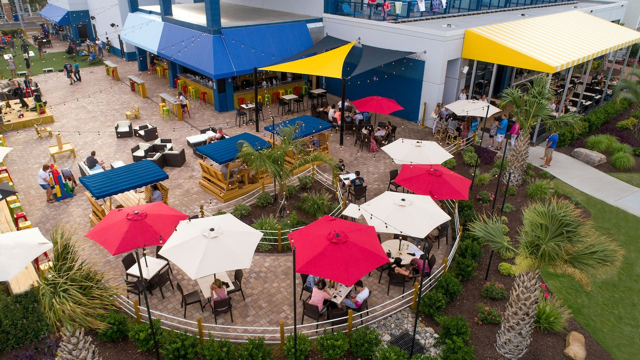 Outdoor patio seating on the boardwalk at Hyatt House Virginia Beach Oceanfront