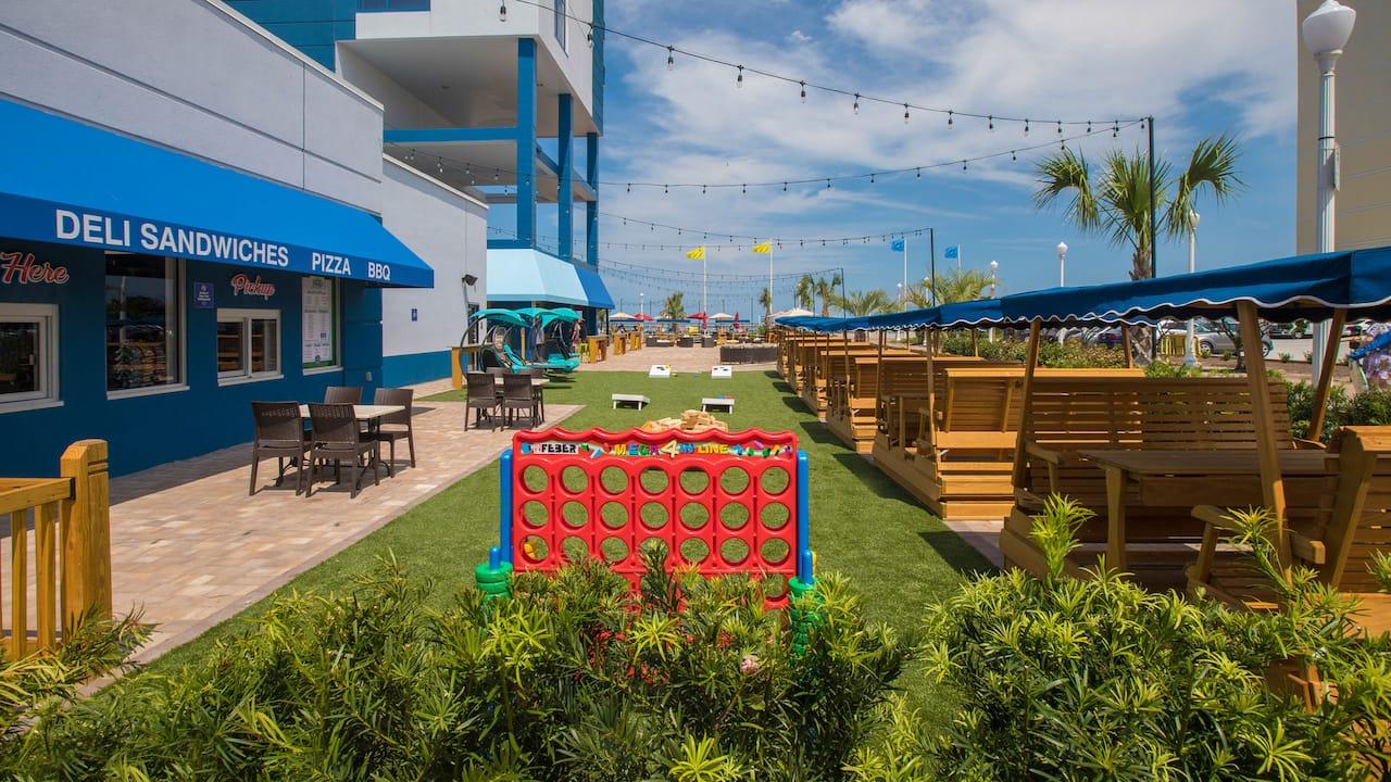 Hyatt House Virginia Beach Oceanfront hotel with outdoor patio games