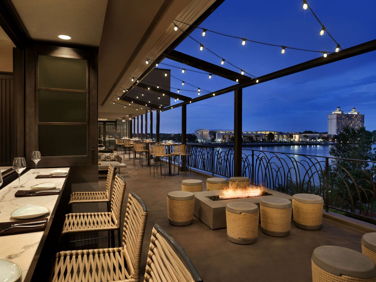 Restaurant tables and chairs on riverfront patio