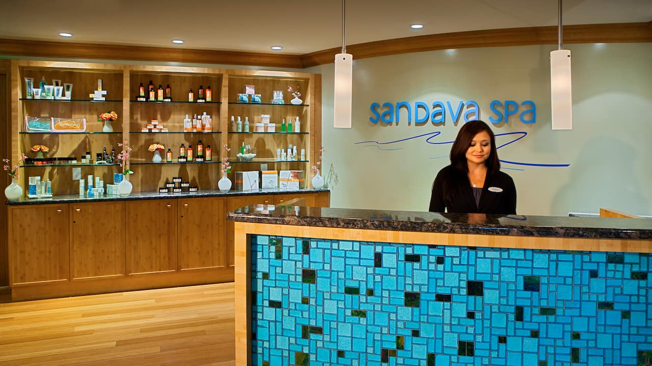 Woman at front desk of spa