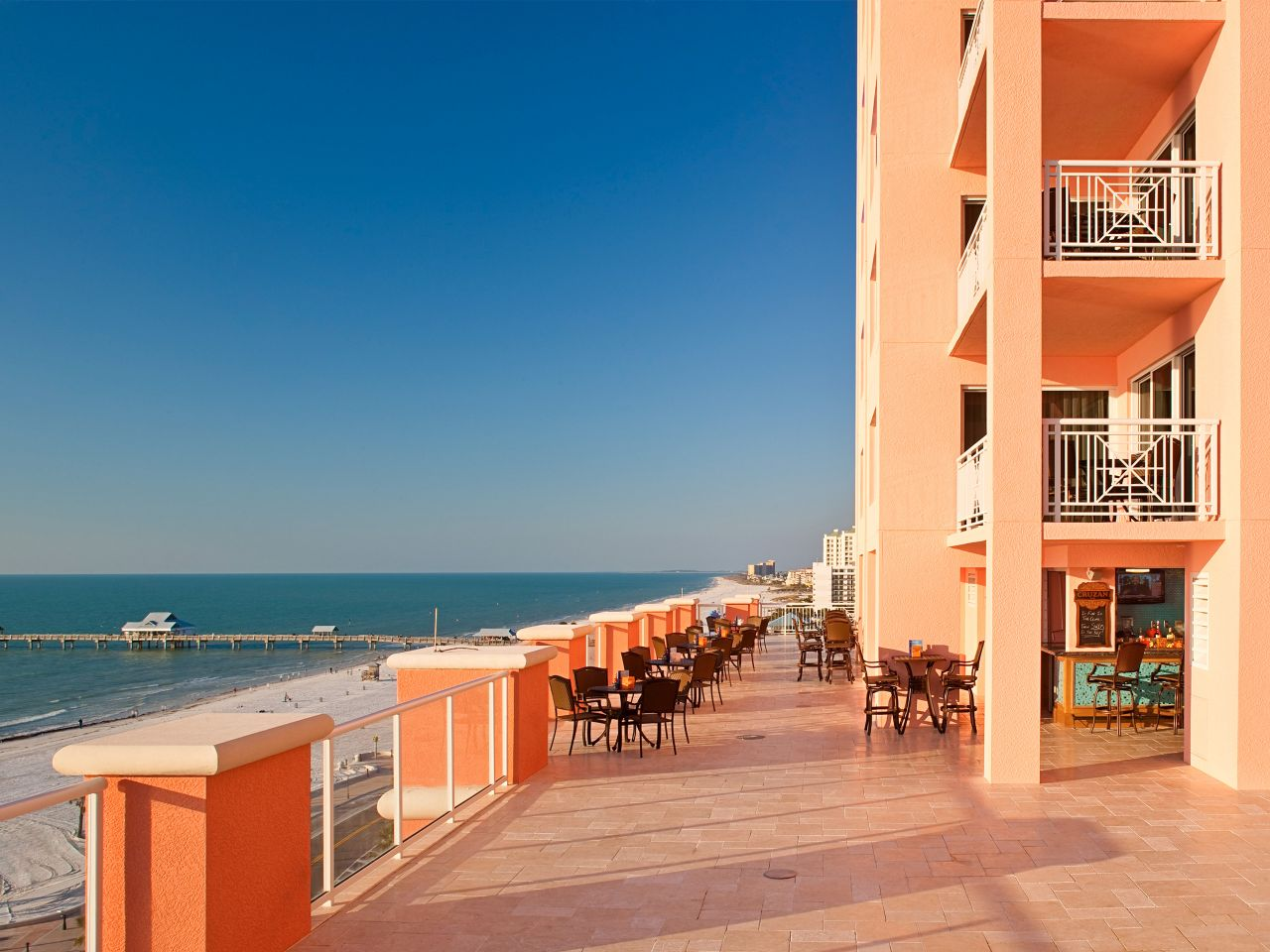 Outside bar on terrace overlooking beachfront
