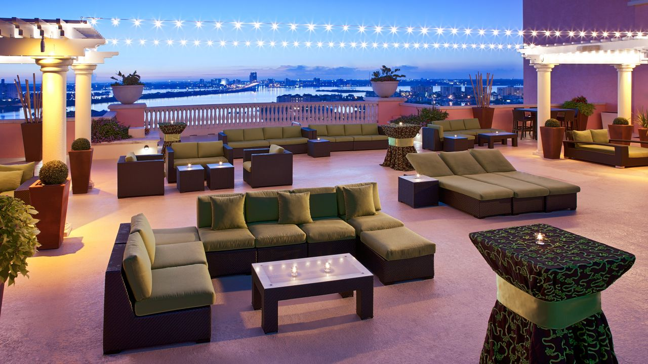 Outdoor couches, chairs and bistro tables on patio