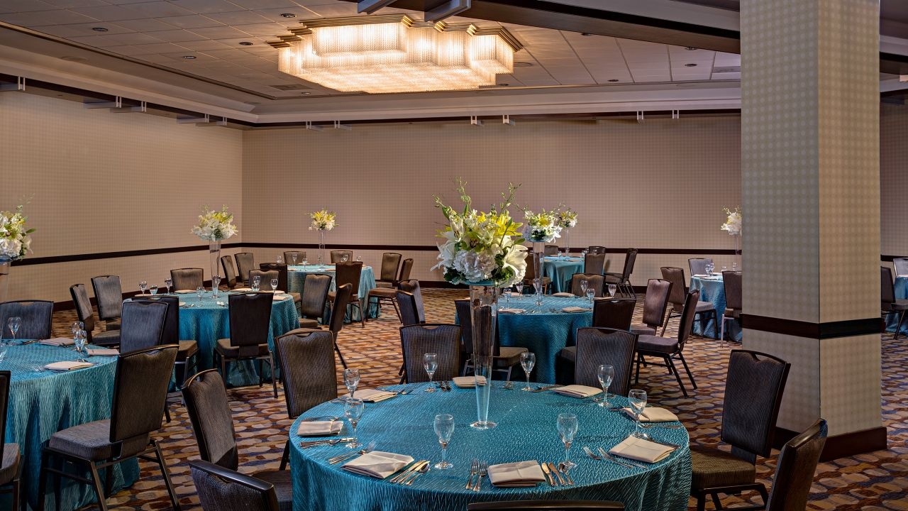 Tables with place settings in hotel ballroom