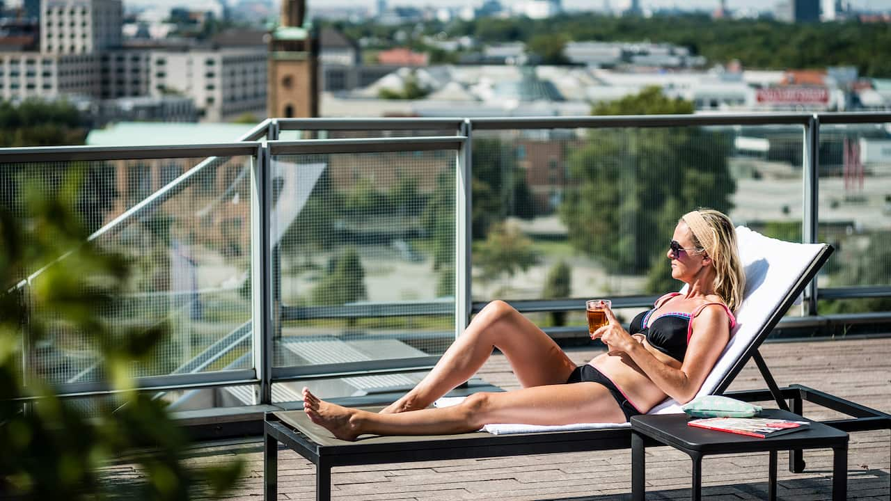 Woman At Rooftop Terrace