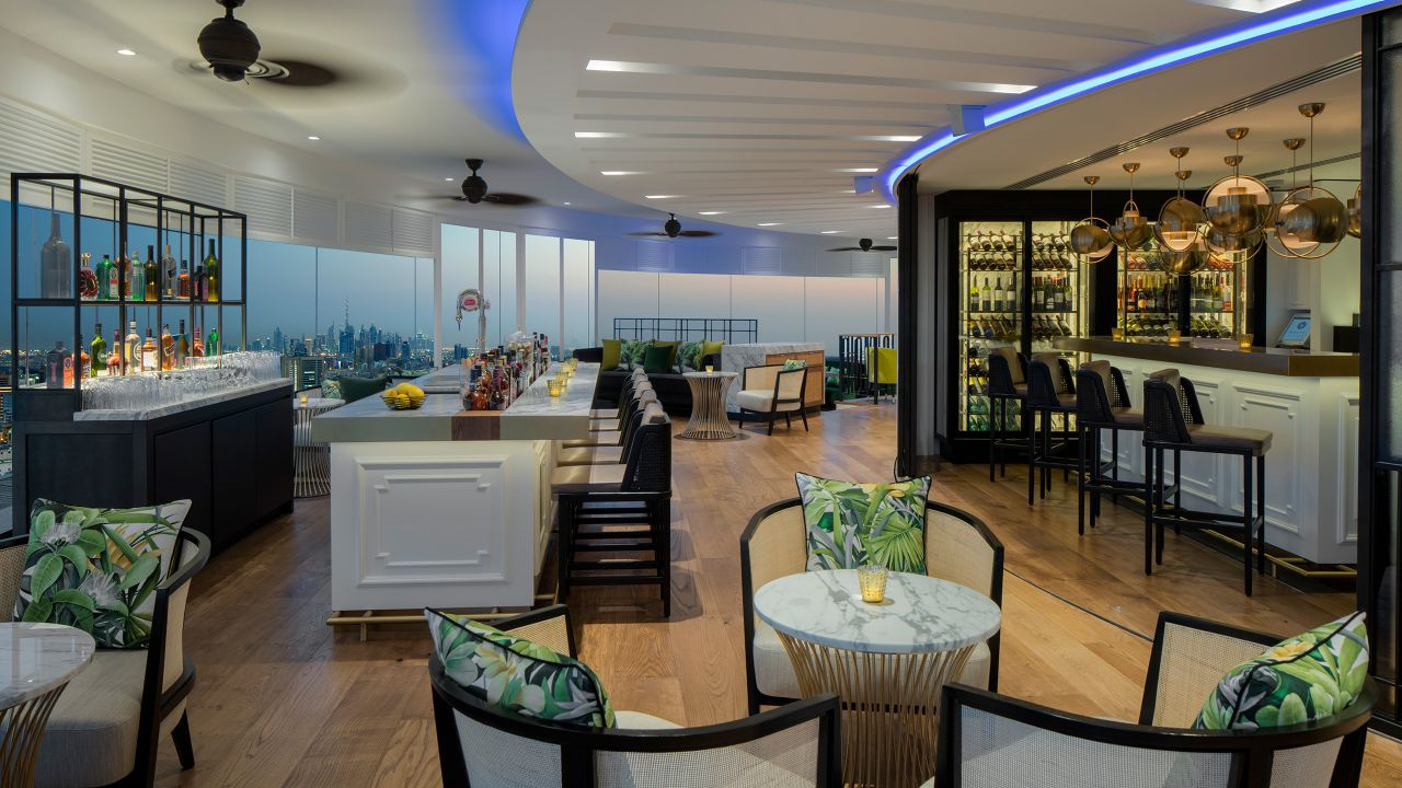 Dining tables and chairs in revolving hotel restaurant