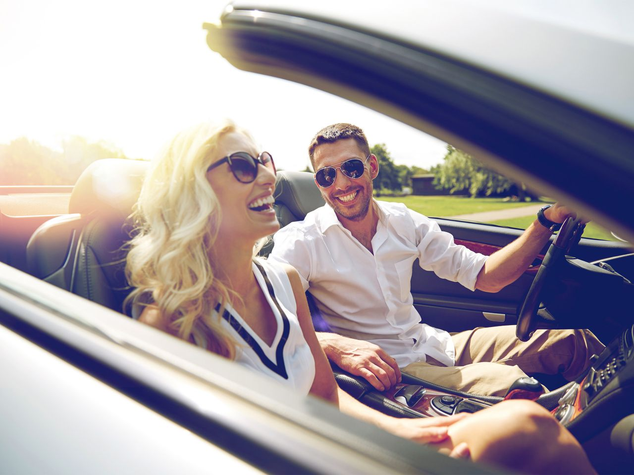 Driving, laughing couple