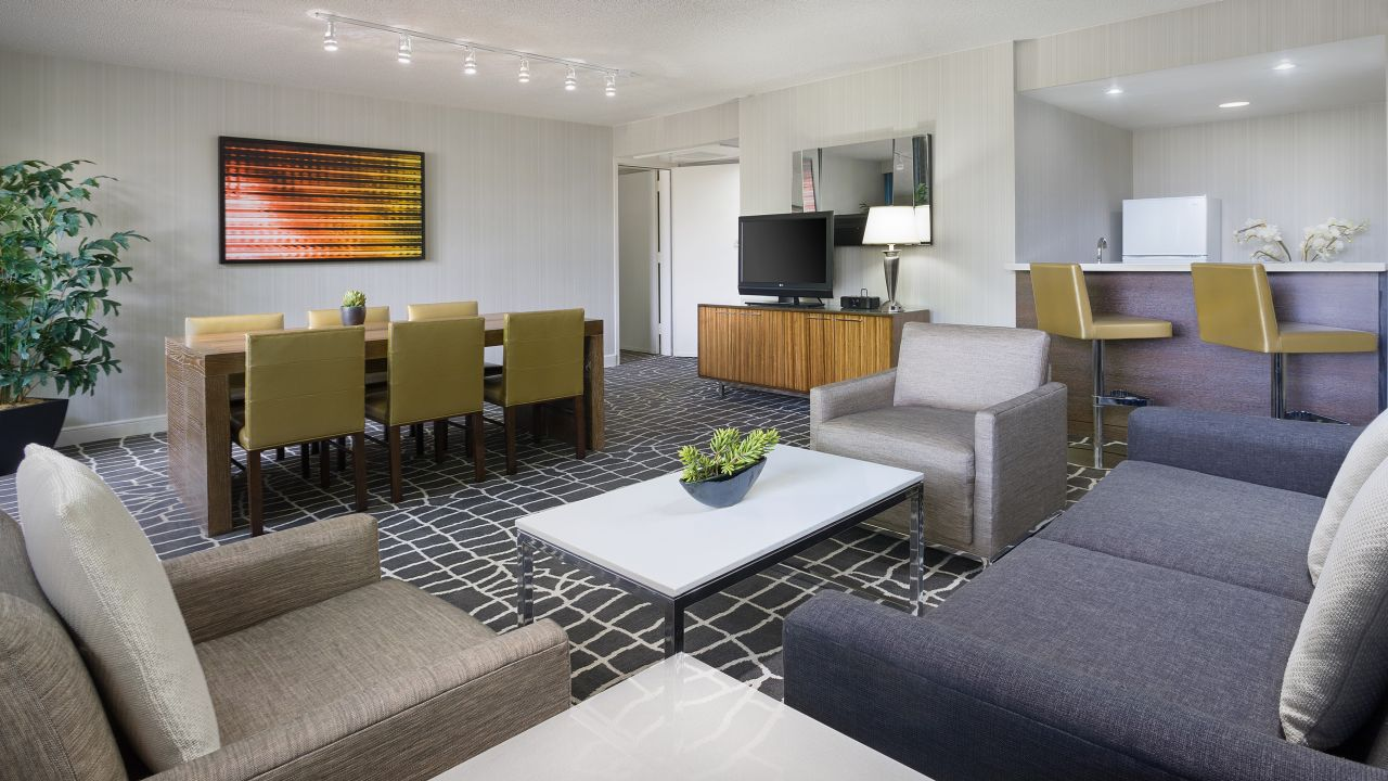 Living and dining areas in hotel suite
