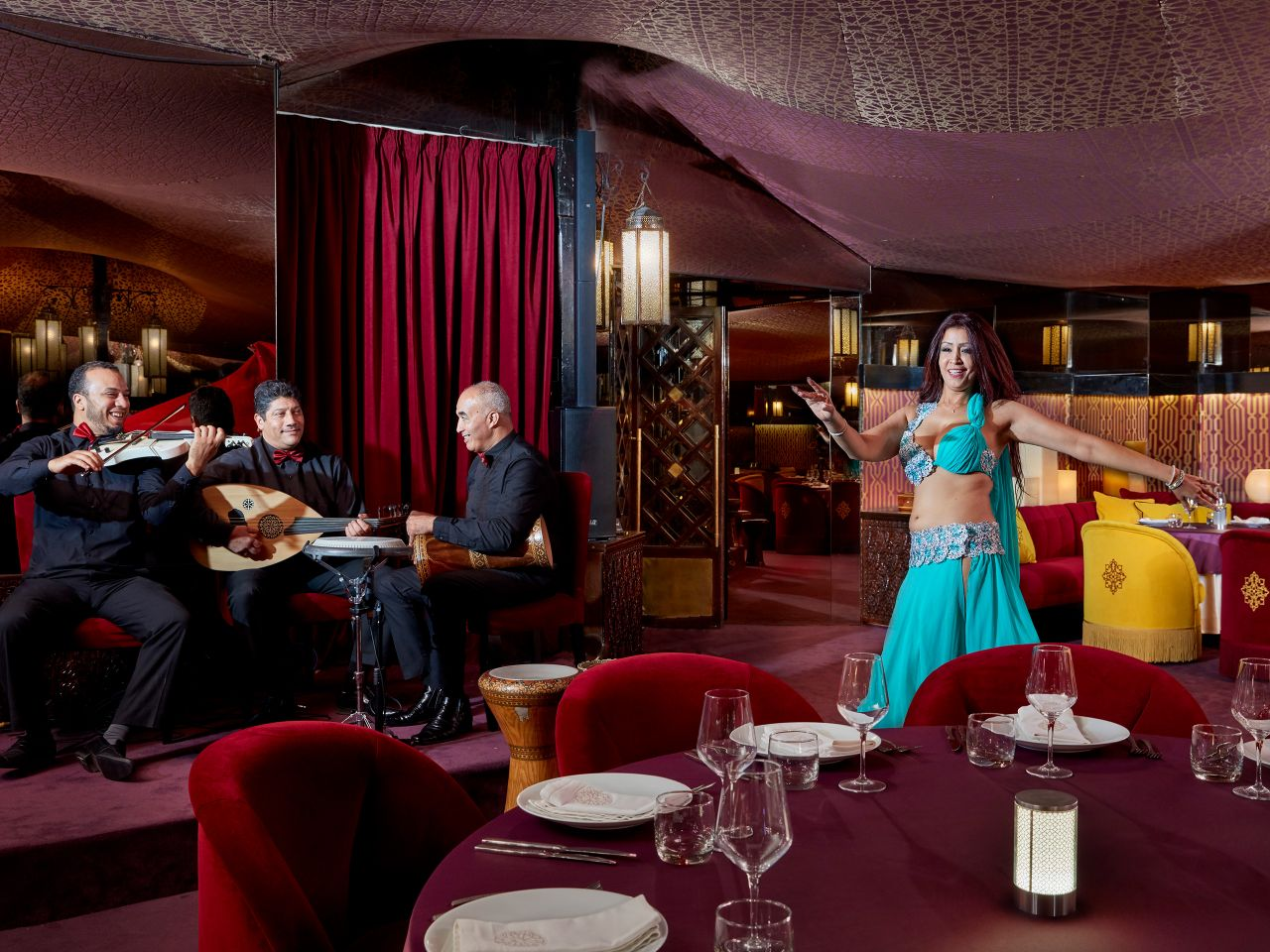 Belly dancer and musicians at Dar Beida restaurant
