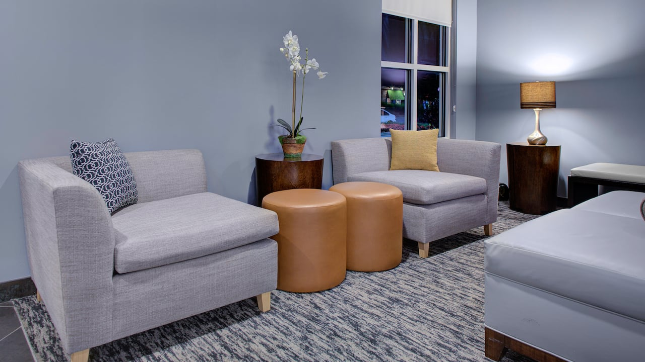 Lobby seating area with couch, lamps, and coffee table at Hyatt House Shelton