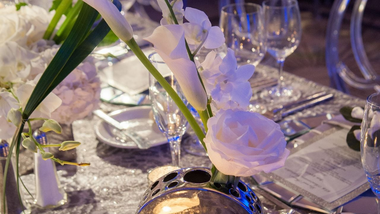 Close up of wedding table setting with bouquet and candle