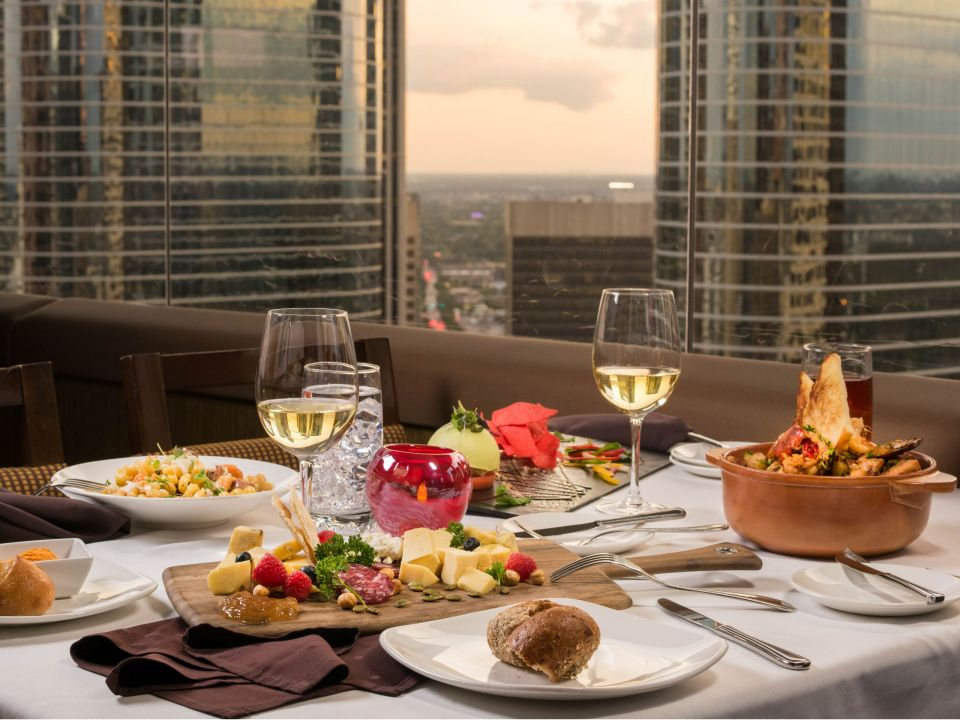 Dinner table set for two at the Spindletop overlooking downtown Houston