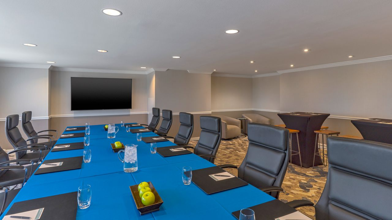 Table and chairs in boardroom