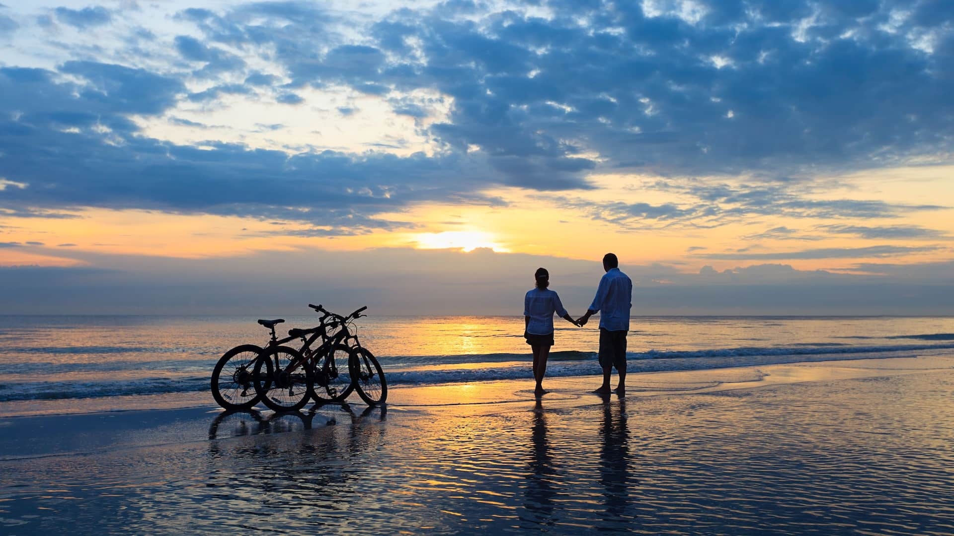 Couple on beach with bikes
