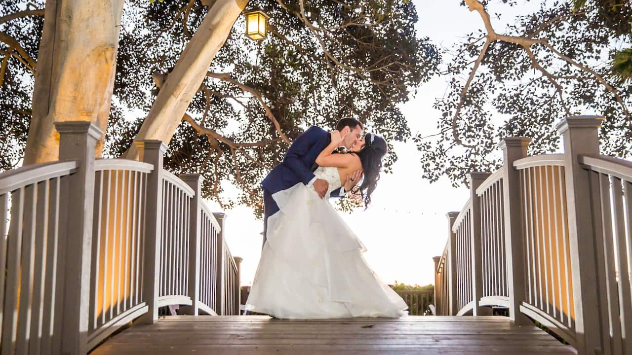 A man and a woman embracing at their San Diego wedding