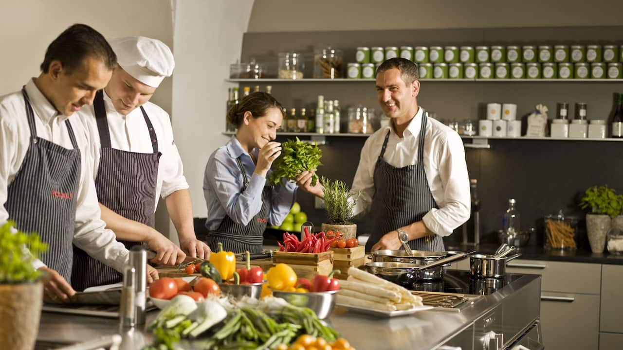 Chefs Preparing Vegetables
