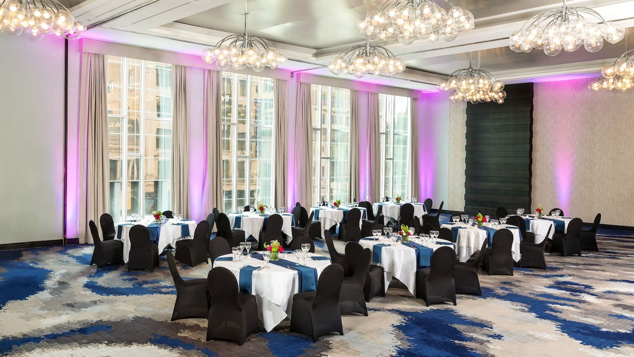 Spacious grand ballroom with natural lighting throughout
