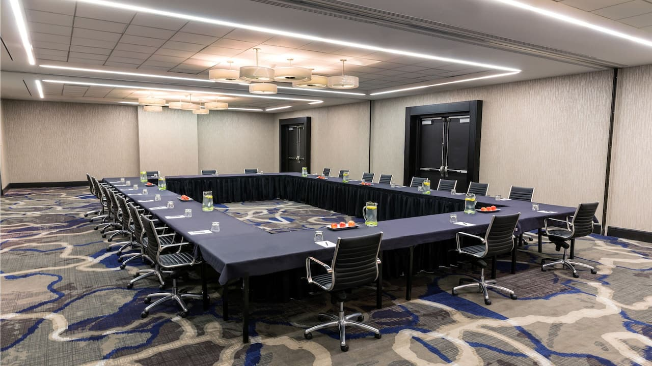 Roomy conference room with a round table style setup