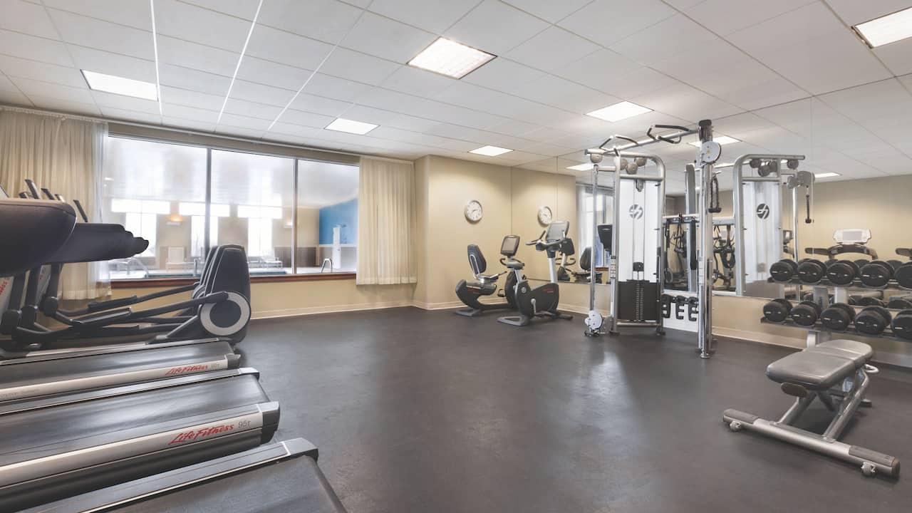 24-hour fitness center including cardio equipment and free weights.