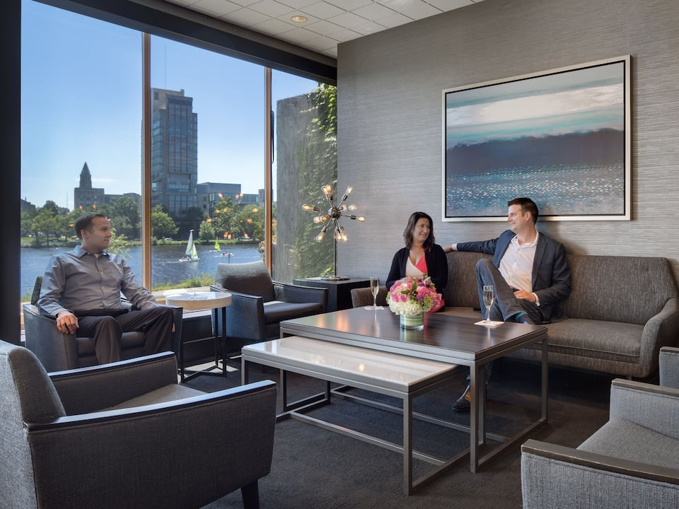 Zephyr Lounge with guests enjoying cocktails while overlooking the Charles River