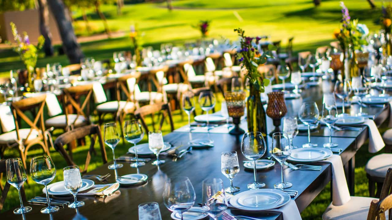 A closeup view of a beautifully decorated dining table for an outdoor wedding ceremony in Palm Springs at Hyatt Regency Indian Wells Resort & Spa