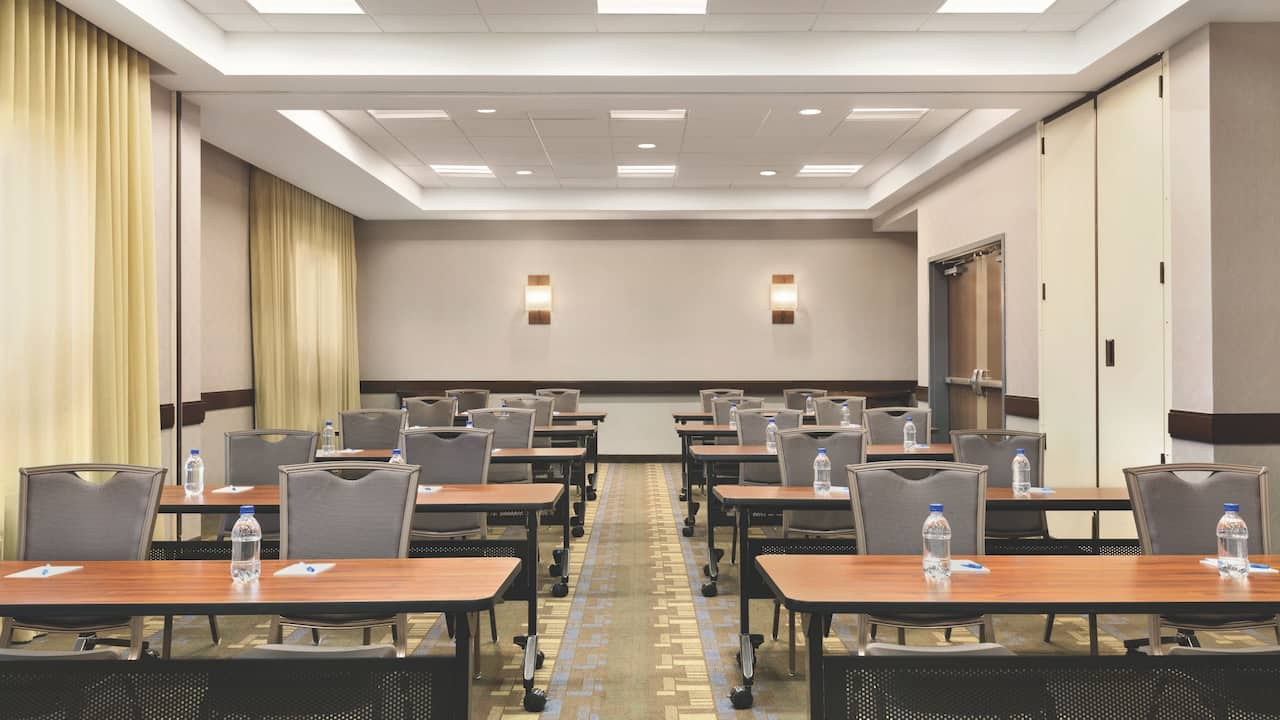 Meeting areas include free Wi-Fi, print/ copy services, and optional on-site catering.