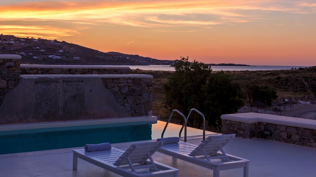 Majestic Beachfront Infinity Pool Villa at sunset